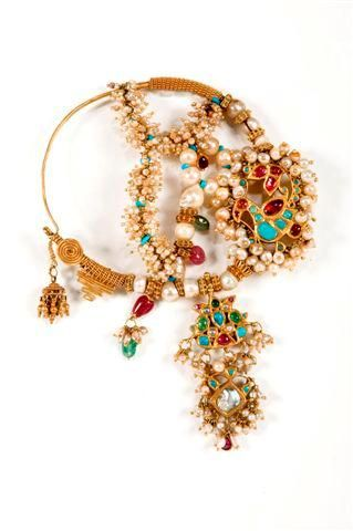 A gold 'Nath', a traditional nose ring, set with rubies, turquoise, and pearls