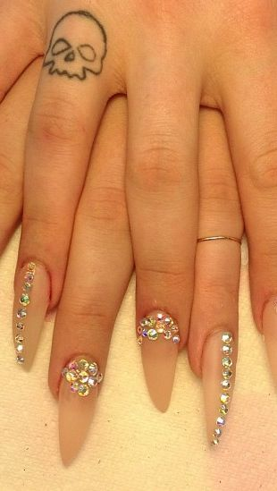 Nude stiletto nails with bling