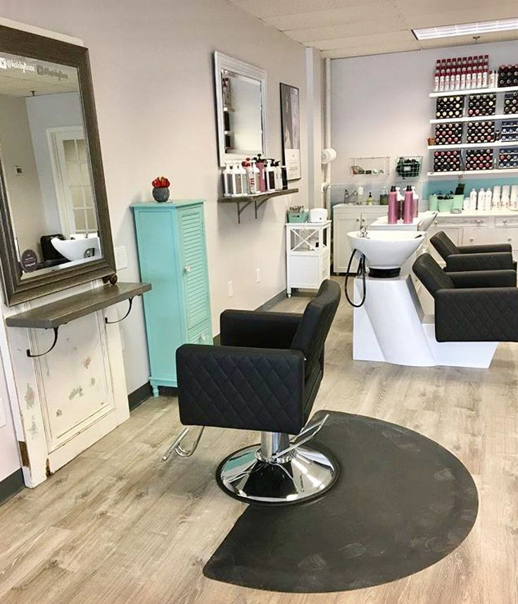 Antique doors used as hair salon stations with Le Beau stylist chairs and tilting shampoo bowls. Vintage coastal theme salon in CT