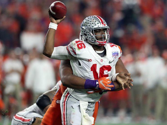 Ohio State quarterback J.T. Barrett (16) throws under