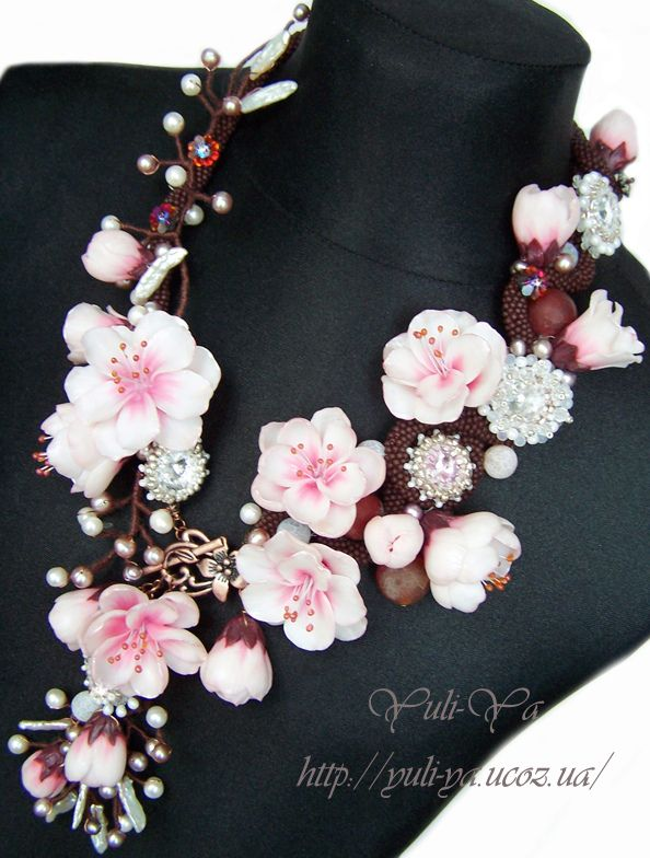 Some of the most amazing work I have ever seen. - Polymer clay flowers necklace.. cherry blossoms perhaps?