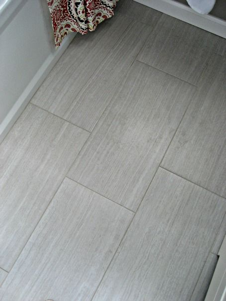Like this color of the faux wood tile. It could also work for a shower.