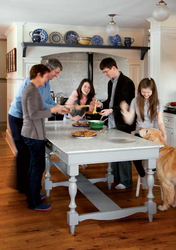 Kathleen and Tom gather around the kitchen worktable with Ali, age 18; Jeff, age 20; Samantha, age 16; and Jackson, the family's golden retriever.