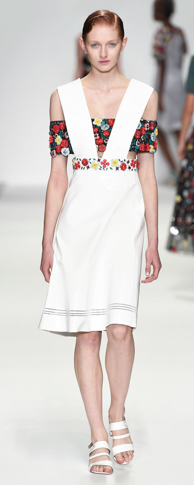 Holly Fulton SS 2015 This collection references American folk life. It uses 3 dimensional floral arrangements out of PVC. The create an intriguing visual against the matte cool wools. Directional line is used to construct a geometric shape over the body.  http://www.hollyfulton.com/collection/ss15