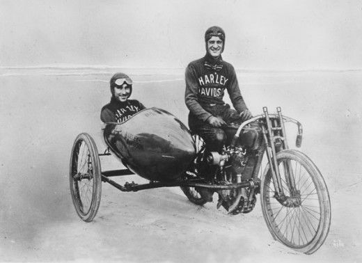 early Harley Davidson motorcycle and sidecar