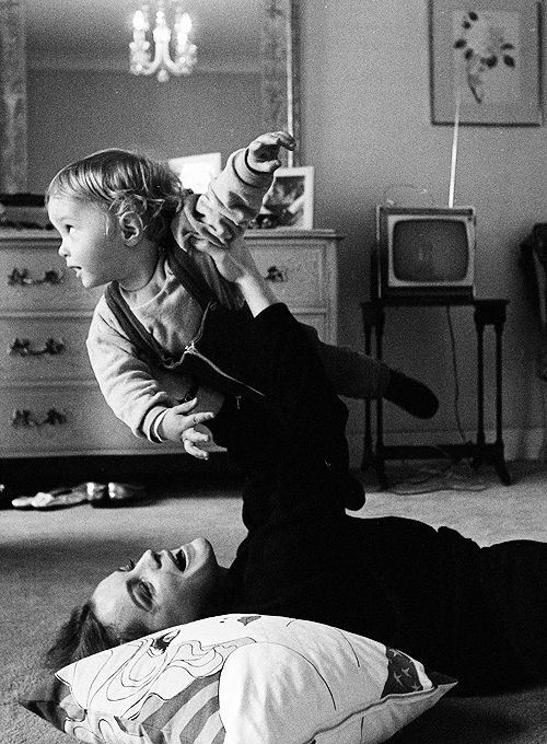 Romy Schneider with her son at home, 1969.