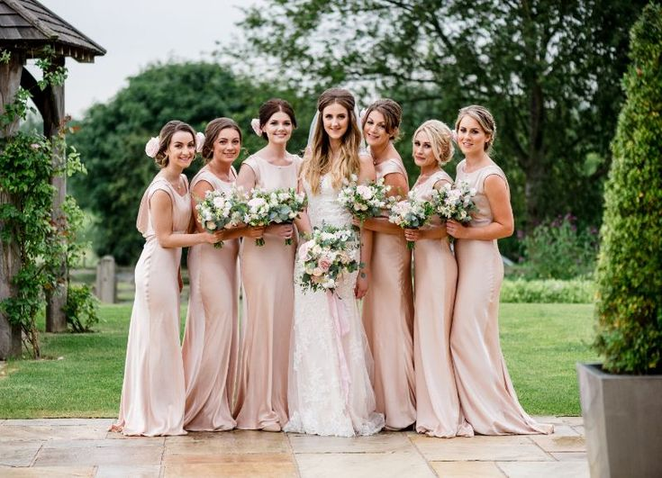 Seasonal flowers for June wedding at Mythe Barn in Leicestershire. Florist: Bloom Fleuriste. Photographer: Lisa Carpenter. Bridesmaids wore blush Ghost dresses and carried posies of avalance roses, sweetpeas, scabious, astrantia, thlaspi and eucalyptus.