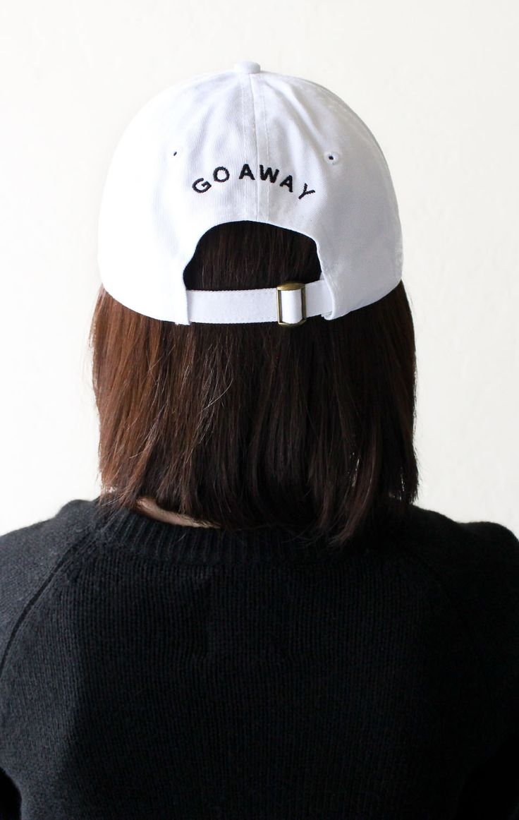 - Description Details: White six panel baseball cap with 'Go Away' embroidery on the back & adjustable back with tri-glide buckle. 100% Chino Twill. Imported. All accessories are final sale. Sizing: O
