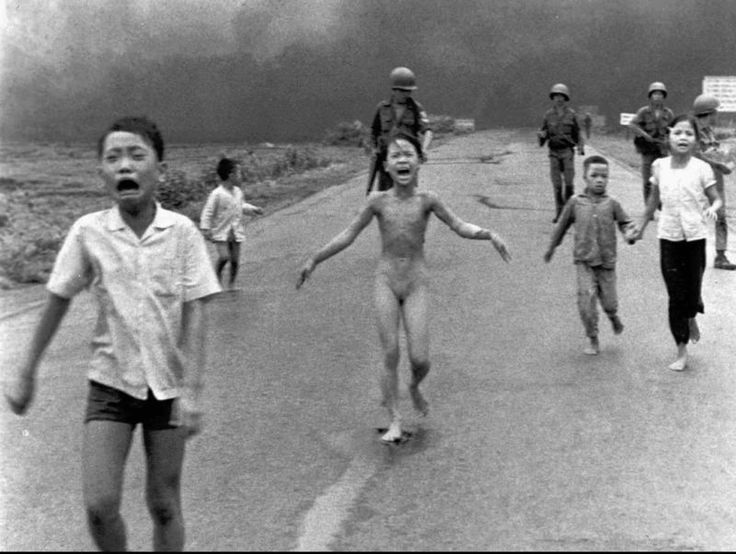 Pulitzer Prize photography by Nick Ut.  June 8, 1972, napalm attack near Trang Bang, Vietnam. Fleeing children with a terrified girl (Kim Phuc), who had ripped off her burning clothes.