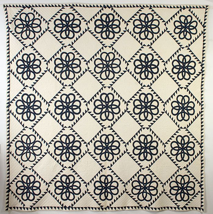 "Celtic Knots. Quilting patterns in the white blocks repeat the knot design. Measures 98"" square. Pennsylvania origin; circa 1870."