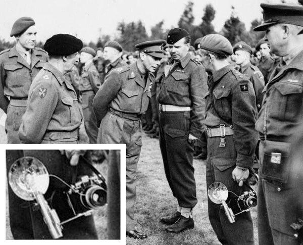 Deze foto werd gemaakt in oktober 1944. King George VI brengt een bezoekt aan de manschappen. De militair met de Kodak Medalist met flitser in zijn hand is legerfotograaf Edward G. Malindine.  De flitser bedient tevens de (draad)ontspanner op de lens, want de camera beschikte toen nog niet over flitssynchronisatie.