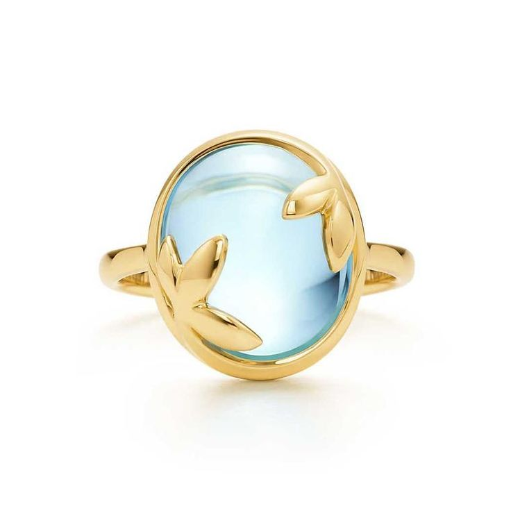Paloma Picasso for Tiffany & Co. Olive Leaf Swiss blue topaz ring in yellow gold. Discover the birthstone jewellery of November with a cool icy blue hue: http://www.thejewelleryeditor.com/jewellery/top-5/top-5-blue-topaz-jewellery-november-birthstone/ #jewelry