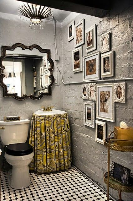 This for my wello house - the 1920's outdoor toilet.   Black seat cover!  Amazing powder room with concrete walls painted gray, Trina Turk Pisces Print - Driftwood Fabric skirted sink, vintage tiles, eclectic art gallery, black mirror and antique gold etagere.