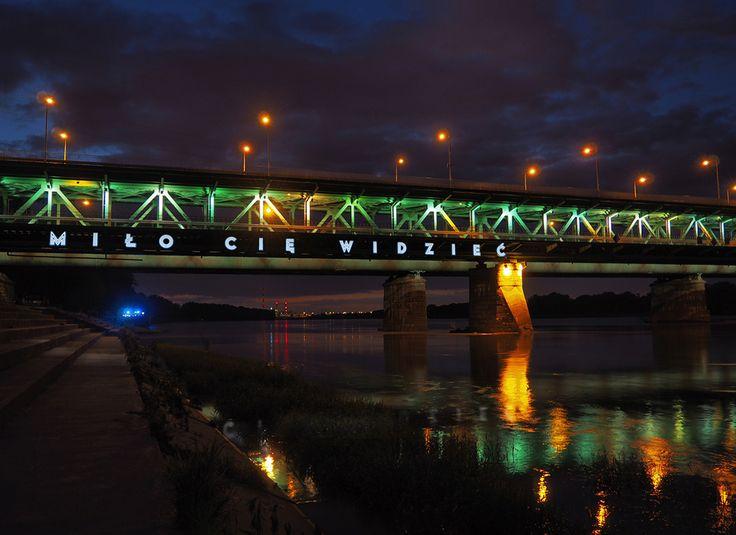 neon MIŁO CIĘ WIDZIEĆ / NICE TO SEE YOU on Gdański Bridge in Warsaw