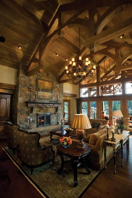 Rustic Living Room With Stone Fireplace Chandelier