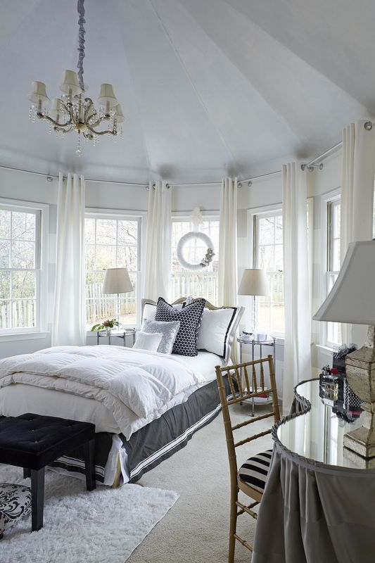Beautiful bedroom interior by Lisa Gabrielson Design. White with perfect touches of black.