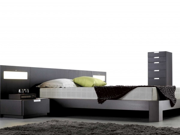 Stella modern wood bedroom collection by Mobican Furniture. Optional lights can be mounted on the wide headboard. Available in several finishes on oak or walnut. Made in Quebec, Canada.