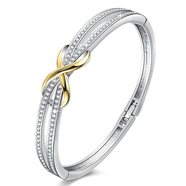 """""""Forever and Ever"""" Infinity Bracelet that is beautifully crafted and two toned. Features 14k White Gold Plated Copper with 18k yellow gold plated infinity, and swarovski crystals. Inner part of the bracelet measures 7"""". #Infinity #Jewelry"""