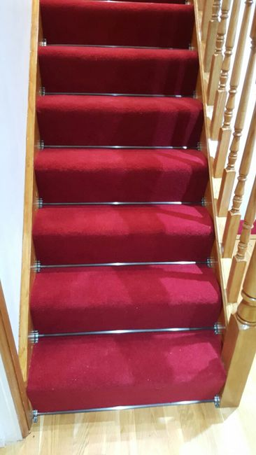 Red Carpet To Stairs With Stair Rods