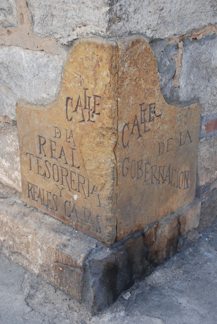 Old street sign carved into the stone building, Pamplona, Colombia