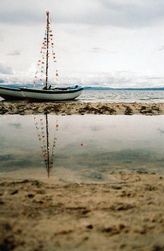 Sweet little boat by the sea