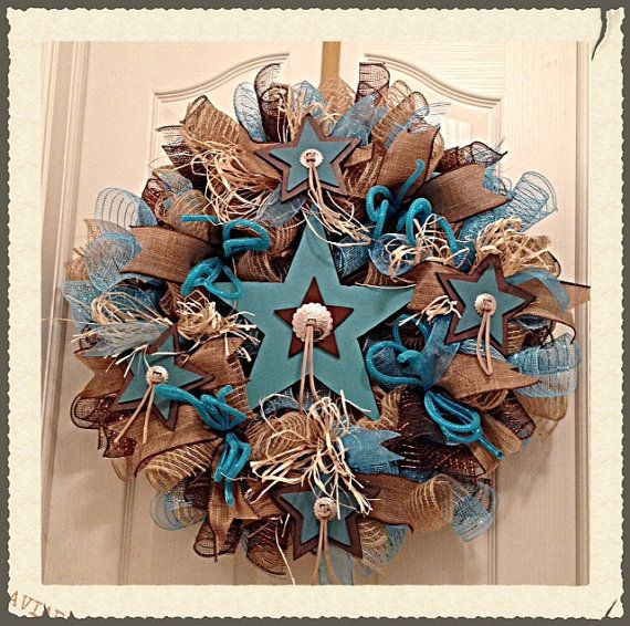 This Western Turquoise star wreath will delight all those that love turquoise!!    It is made with burlap, turquoise and chocolate deco mesh.