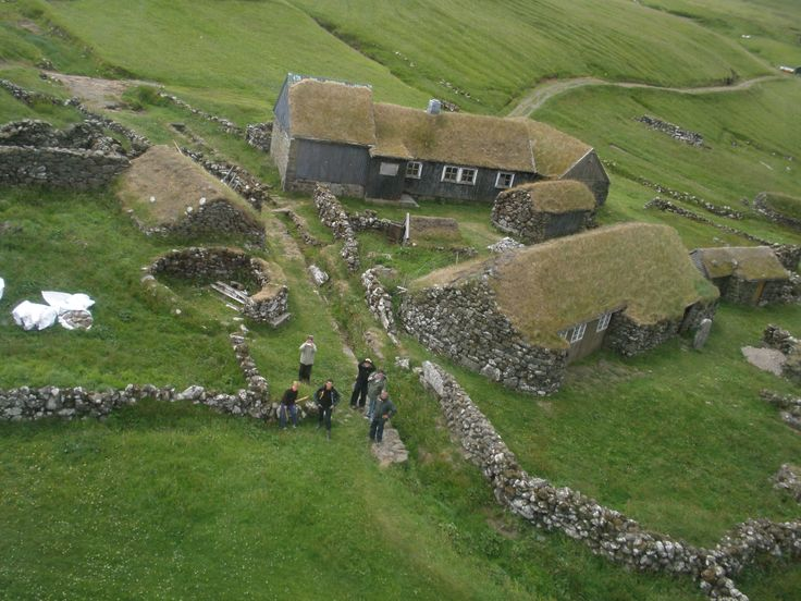 A view from the helicopter of the small island Koltur. (At least I think that's where it is - I can't quite remember.)  It shows a traditional Faroese farm.  As is often the case throughout the islands, the buildings have turf roofs.