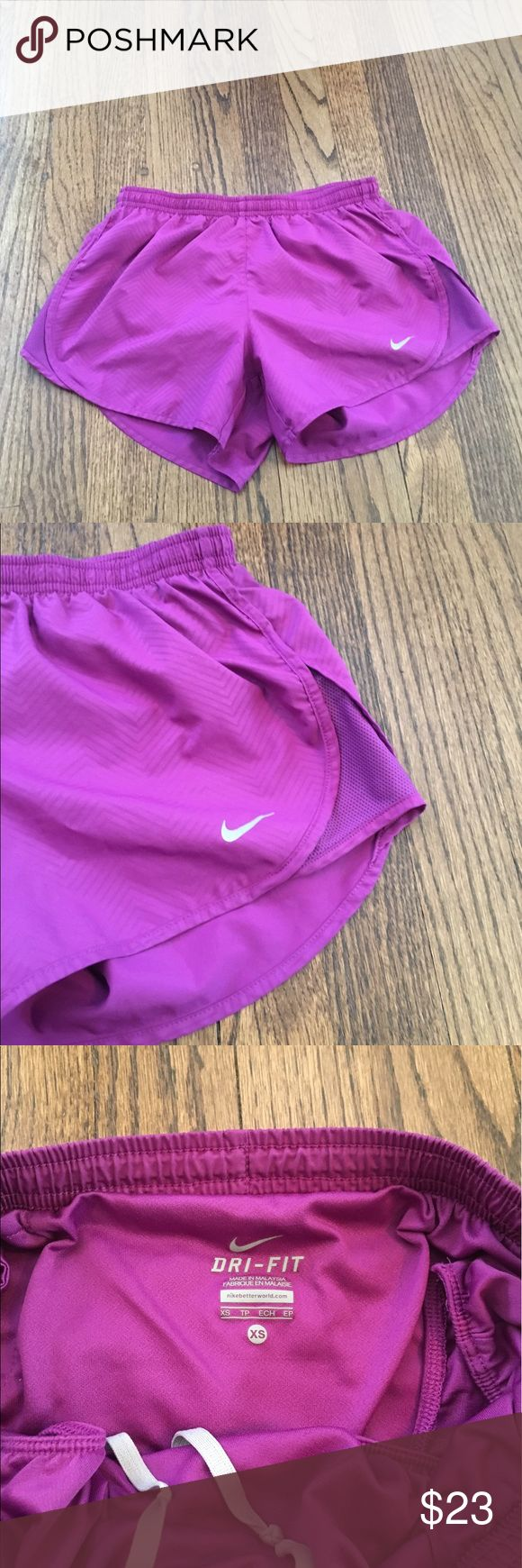 Nike Dri Fit shorts Women's purple Nike Dri Fit shorts.  Very good condition - worn and washed a couple times.  Has drawstring on inside and a zipper pocket on back for your key.  Comes from a smoke free home! Nike Shorts