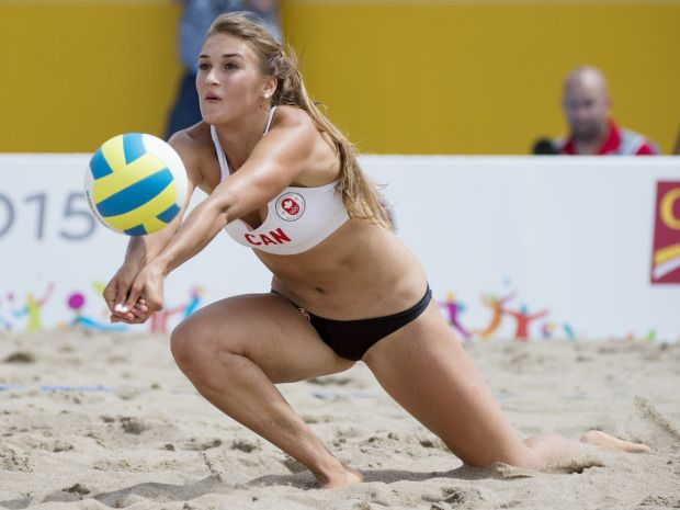 July 14 - Beach Volleyball - Women - Preliminary Round. Canada vs Puerto Rico. Taylor Pischke is the daughter of Garth Pischke, a two-time Olympian as a player, a long-time coach of the national team and the most decorated coach in Canadian university history. Tyler Anderson / National Post