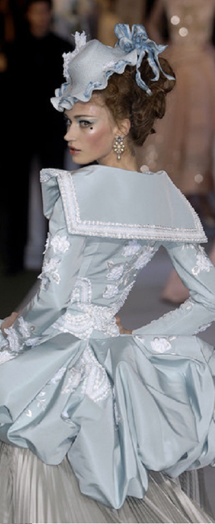 Christian Dior SS2007 | John Galliano. Pastel color with a big skirt and a head with hat.