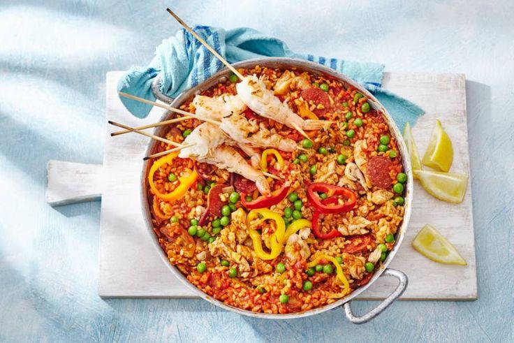 Kijk wat een lekker recept ik heb gevonden op Allerhande! Paella met kip en gamba's