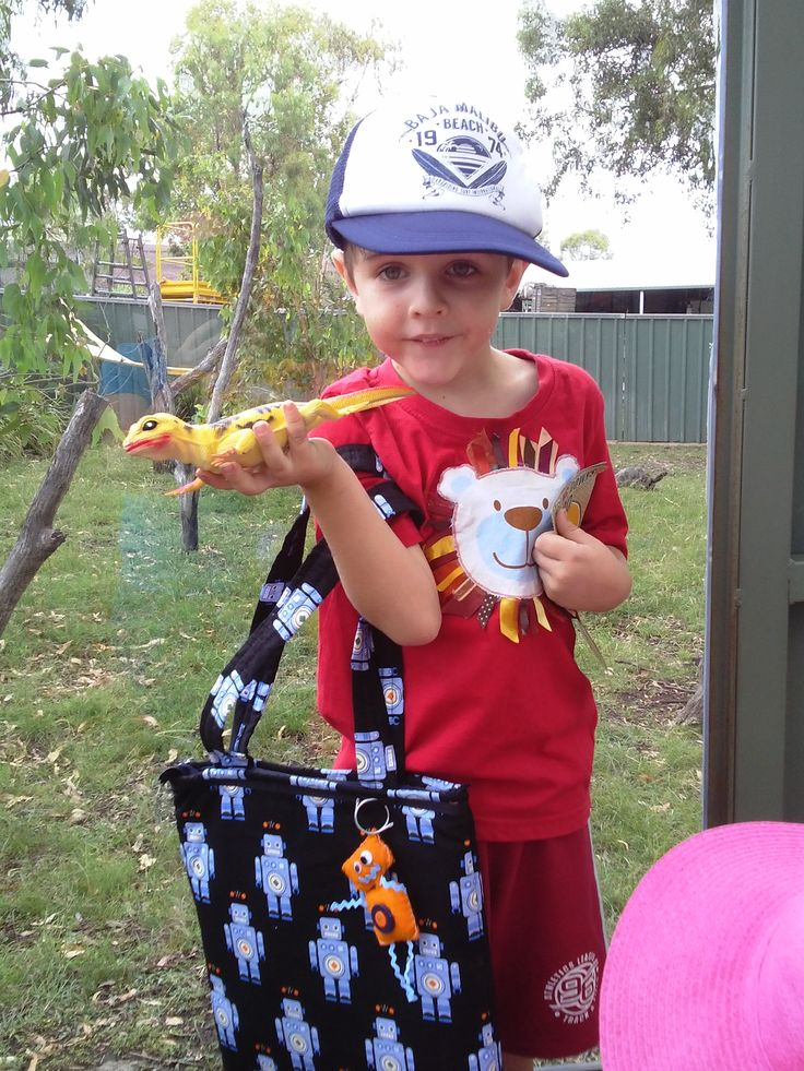 Handmade Robot Bag by Bubblegum Treehouse made for my son with matching crayon/pencils roll. Also modeling his Lion Tshirt handmade by Bubblegum Treehouse