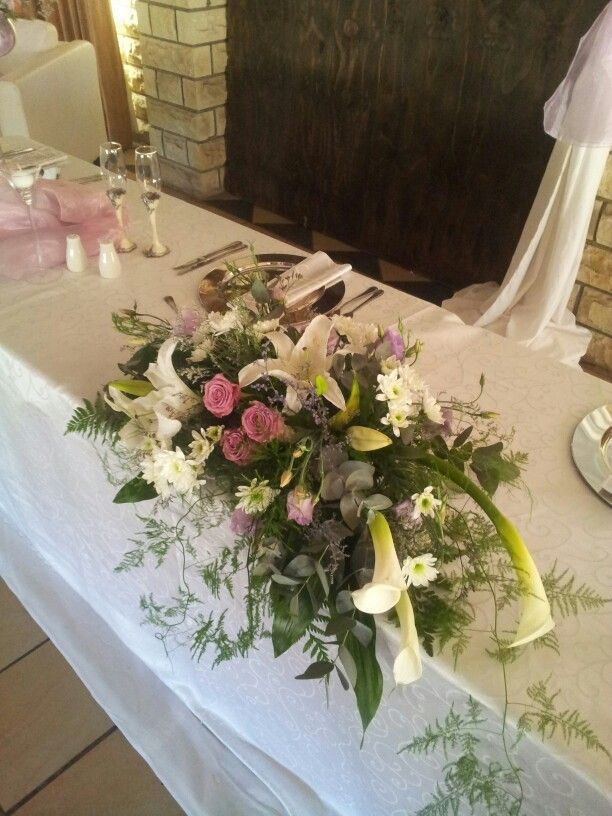 Casablanca lilies, coolwater roses and arum lilies, colour scheme: lilac and pink Flowers by Vergeet - My - Nie www.vergeetmynieflorist.co.za