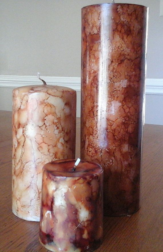 Hey, check out these really awesome alcohol ink candles.