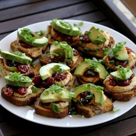 Hummus, Avocado, and Craisin Crostinis Toast up some small slices of whole grain bread and top with a smear of hummus, a little slice of avocado, a few dried cranberries, and some chopped chives. Source: Flickr user California Avocados