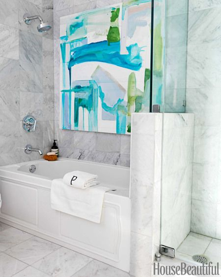 An abstract painting adds a burst of tropical colors to the master bath.
