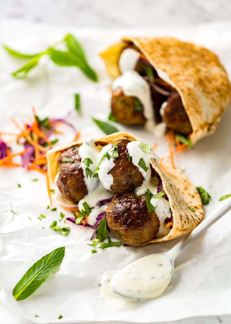 Plump, juicy, beautifully spiced Moroccan Lamb Meatballs with Minted Yoghurt. Pan fried or baked. Stuff in pita pockets, pass around at a party or pile over pilaf!