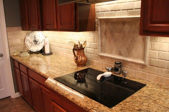 St Cecilia Granite Countertops With Framed Backsplash And Under Cabinet Lighting