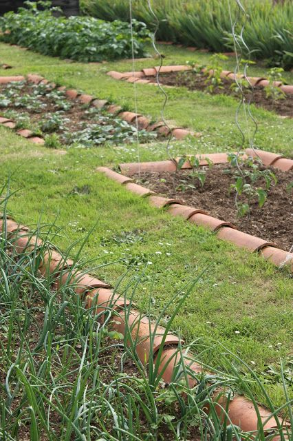 Some of the veggie beds:  http://soupedupgarden.blogspot.fr/2016/06/walk-on-wild-side-and-various-harvests.html