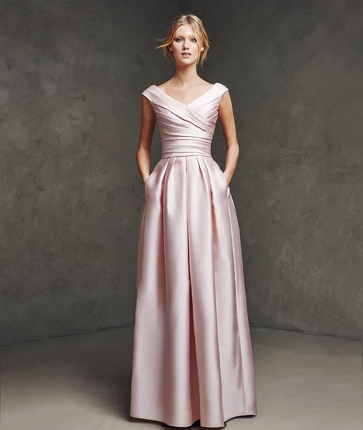 LASIRA- Mikado silk flared skirt. Draped bodice with V-neckline front and back. Pleated skirt with side pockets.