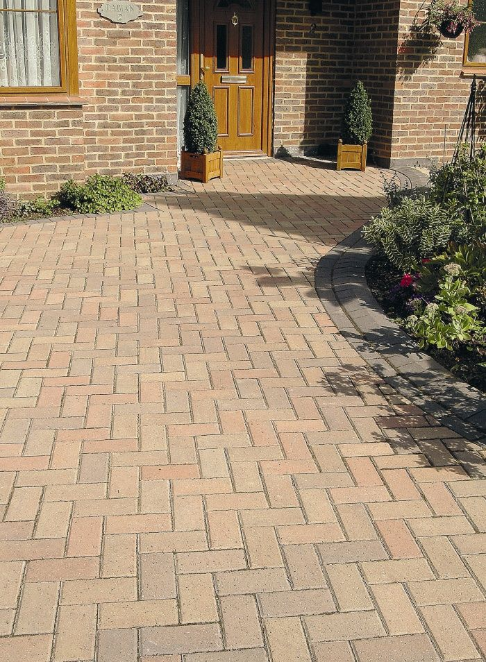 A modern block paved driveway featuring Brett Omega multi colour 50mmx200x100mm brick paving