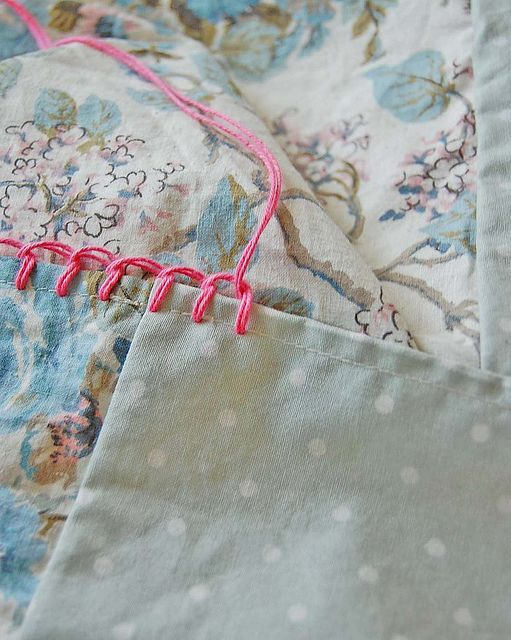 Hand stitched blanket stitch as foundation row for crochet edging on pillowcases.