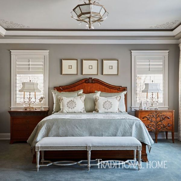 The Bed And Bedside Tables Stained In Wood Tones Contrast With Gray Walls And A Louis Glamorous Bedroomsbeautiful