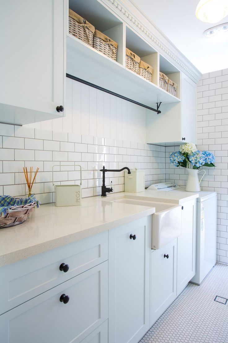 61 best laundry images on pinterest the laundry laundry room vintage style fittings and fixtures bring a classic look to this laundry design by
