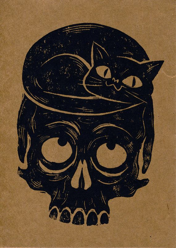 Black cats know skulls make the most comfortable, and stylish, of beds. (Cat and Skull Lino-cut by PaperWaspNest)