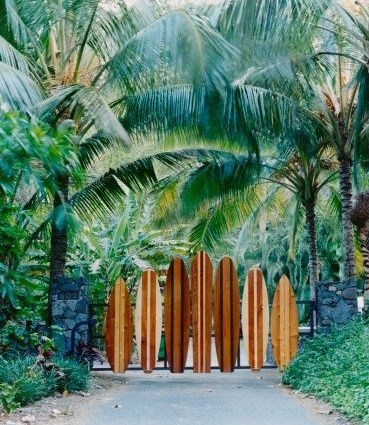 Tropical House Entrance; great texture and pattern from the wooden surf boards!