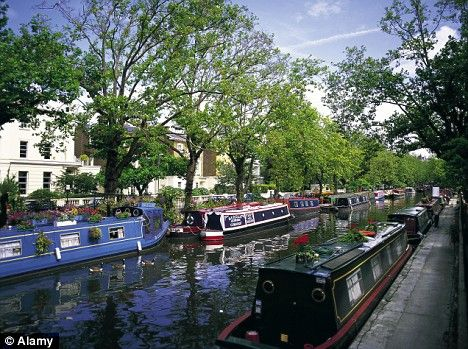 Houseboats on Regents Canal at Little Venice in London.  Have lunch in the picturesque area and then take a boat tour winding down the Thames