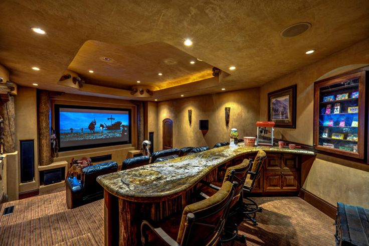 Home theater with snack bar counter - Brown and gold tones can turn any room into a desert or desert movie themed room. - Use a movie room to watch online tv and movies. This allows for a clean living room/family room. Use as a dining area or company lounge.