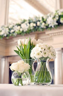 single color, one type of flower per vase, lots of different vases. so clean and pretty