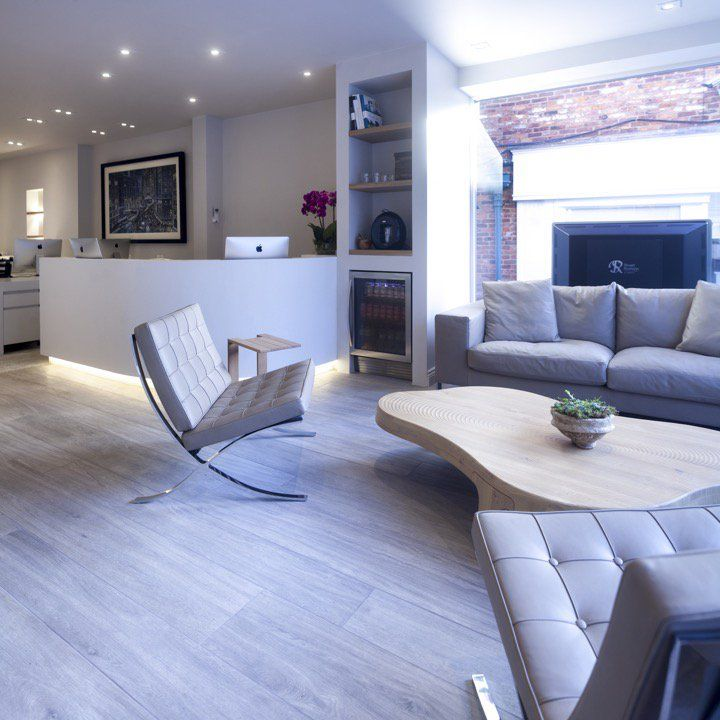Stylish reception area with curved reception desk for Estate agency interior design